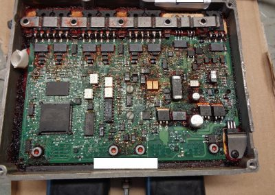 EVINRUDE ECU-EMM electronics module after removal of sealing material during the repair process.
